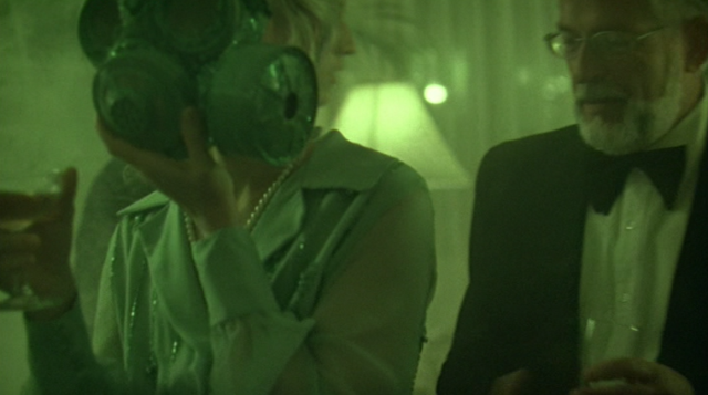 I love the gas mask chic asphyxiation theme of the party at the end